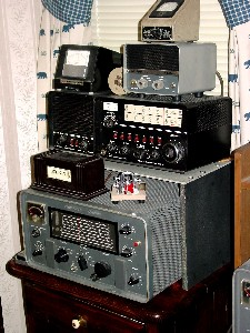 Hammarlund HX-50 Transmitter, Drake 2B/2BQ receiver/q-multiplier, Hallicrafters TO keyer, Vibroplex paddle, Pennwood Numechron Tymeter, B&W SWR meter and Turner microphone.